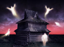 Haunted. Ghosts flying around decrepit and abandoned house Stock Image