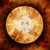 Haunted Autumn. Design with ghostly female face materialising within an antique clock dial against an ethereal background of rippling water and leaves stock image