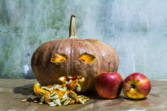Haunted carved pumpkins for Halloween with apple Stock Photos