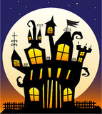 Haunted Castle. Crazy off-kilter haunted castle against a moonlit night Stock Photos