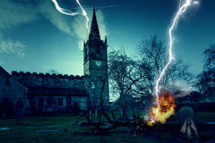 Haunted Church Graveyard. Photo of a Haunted Church Graveyard with Ghost and Lightning Stock Image