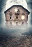 Haunted derelict old house. Halloween design. Haunted derelict old house in the night. Halloween design stock image
