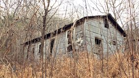 Haunted. Exterior photo of an abandoned home in the backwoods of West Virginia Stock Photos