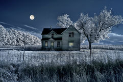 Haunted Farmhouse and Full Moo. Haunted farmhouse under a full moon in infrared Stock Photography