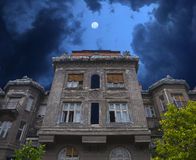 Haunted house. Old haunted house. Stormy clouds and moon can be seen behind it stock photography