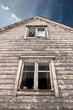 Haunted house. Old haunted house with two dark windows Royalty Free Stock Photos
