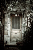 Haunted house. Desaturated picture of an abandoned house entrance, so it looks like a haunted house Royalty Free Stock Image