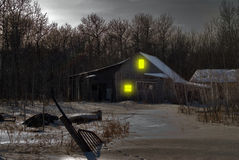 Haunted House. An old house in the middle of winter with snow on the ground and junk in the yard Stock Photography