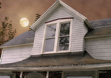 Haunted House. Old farmhouse with moonlit sky behind Stock Photos