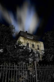 Haunted House. With fence and dramatic night sky royalty free stock photos
