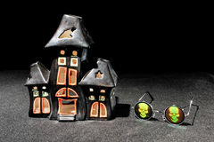 Haunted house candle holder and skull glasses Stock Image