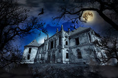 Haunted House. In creepy foggy background with tree silhouettes stock photos