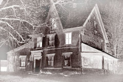 Haunted house in the fog Stock Images
