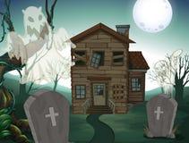Haunted house and graveyard at night Royalty Free Stock Photos