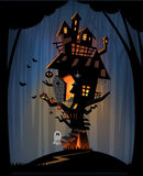 Haunted house on Halloween night. The illustration of Halloween night background. Big trees and a haunted house in the dark woods. A ghost and pumpkins for trick Royalty Free Stock Image