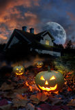 Haunted house halloween pumpkins Stock Photo