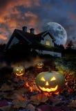 Haunted house halloween pumpkins. Halloween pumpkin lanterns in haunted house garden stock illustration