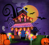 Haunted House. Illustration of a haunted house with landscape and pumpkins Bats flying in background with ghost. House has hanging candycorn lights and lollypop Stock Photography