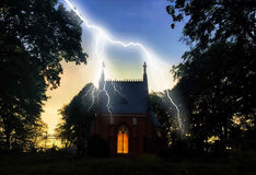 Haunted house with lightning at night Royalty Free Stock Photo