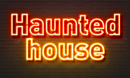 Haunted house neon sign on brick wall background. Stock Photography