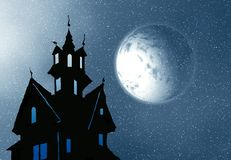Haunted House at Night. Halloween haunted house in the dark with a glowing moon Stock Images