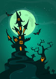 Haunted house on night background with a full moon behind. Vector Halloween background. Stock Photos