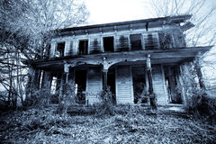 Haunted House. Old haunted house in the woods royalty free stock image