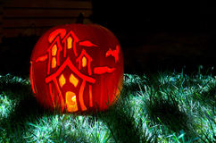 Haunted House Pumpkin Carving. Long Exposure shot of a Pumpkin House. Haunted House lit up using a candle and flashlight used for light trails Royalty Free Stock Images