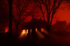 Haunted House in red fog stock photo