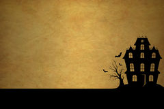 Haunted House. The silhouette of a haunted house, against a grunge background. Room for copy Stock Photo