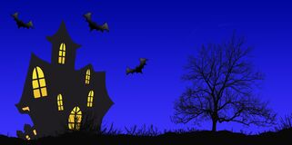 Haunted House  silhouetted againist the evening sunset on Halloween night