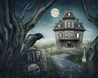 Haunted house. And spooky graveyard royalty free stock images