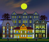 Haunted houses at midnight. Haunted houses, very elaborate and  decorative, great for children, backdrop and theater scenery Royalty Free Stock Photos