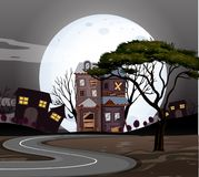 Haunted houses on the road at night Royalty Free Stock Photo