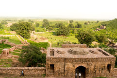 Haunted indian city of Bhangarh. Bhangarh, India; 17th Aug 2014 : Tourists visiting the ruined fortress in the ancient city of Bhangarh. This palace which Royalty Free Stock Image