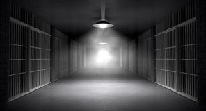 Haunted Jail Corridor And Cells. An eerie haunting corridor in a prison at night showing jail cells illuminted by various ominous lights Royalty Free Stock Photography