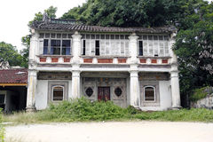 Haunted mansion. An image of a old dilapidated Oriental mansion in a rural surrounding royalty free stock photos