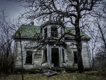 Haunted. Old abandoned house in the middle of the woods. urban exploration Royalty Free Stock Images