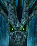 Haunted Tree. With a mythical dark forest and an evil plant shaped as a demon spirit skull face as a halloween or ghost related concept of monsters and Royalty Free Stock Photo