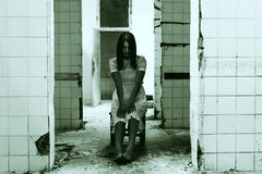 Haunted Woman in demolished room. Barefoot female in demolished room stock photos