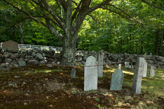 A Haunting Graveyard. A New England graveyard evokes thoughts of ghosts and goblins soon to be haunting the nether regions Stock Photos