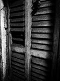 Haunting huge window. Abstract photography of an old creepy window in black and white Stock Image