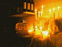 Bar Light. Dripping and haunting candles in a dark pub in Dublin, Ireland royalty free stock images