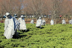 Haunting scene in 19 sculptures of soldiers posed for fight, Korean War Veteran's Memorial, Washington,DC,2015. Moving landscape of 19 stainless steel sculptures Royalty Free Stock Image