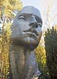 Statue of a Face in the Woods stock photos