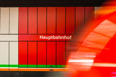 Hauptbahnhof German Train Station Sign Red Motion Blur Wagon Pas. Sing Moving Symbol Text Royalty Free Stock Photography