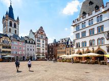 Hauptmarkt and view of St Gangolf Church in Trier. TRIER, GERMANY - JUNE 28, 2010: tourists on Hauptmarkt Main Market square and view of St Gangolf Church in Royalty Free Stock Photo