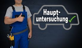 Hauptuntersuchung in german general inspection car and craftsm. An with thumbs up stock photography