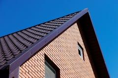 Haus auf backgrounde Himmel Lizenzfreie Stockfotografie