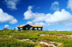 Haus auf die Hügeloberseite stockfoto